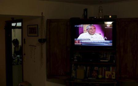 Panama's former dictator Manuel Noriega is seen on a television screen in Panama City