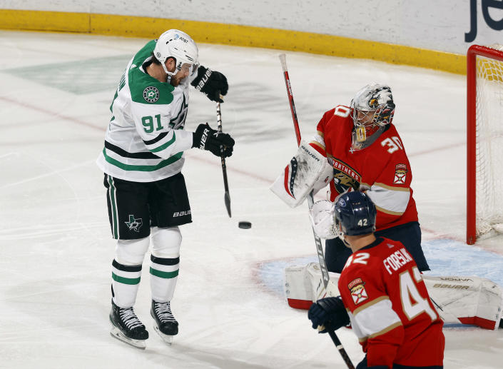 File-This May 3, 2021, file photo shows Dallas Stars center Tyler Seguin (91) scoring a game-tying goal past Florida Panthers goaltender Spencer Knight (30) during the third period of an NHL hockey game, in Sunrise, Fla. Six months and a day after his hip surgery, during a span when he also had arthroscopic surgery on his right knee, Seguin returned to the ice for the Dallas Stars by playing twice as long as planned and scoring a game-tying goal that forced overtime Monday, May 3, 2021, at Florida.(AP Photo/Joel Auerbach, File)