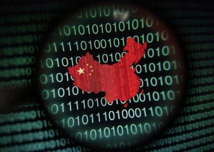 FILE PHOTO: A map of China is seen through a magnifying glass on a computer screen showing binary digits in Singapore in this January 2, 2014 photo illustration. REUTERS/Edgar Su
