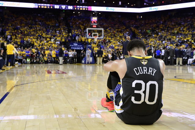 Golden State Warriors guard Stephen Curry reacts after teammate Klay Thompson was injured during the second half against the Toronto Raptors in Game 6 of basketball's NBA Finals, Thursday, June 13, 2019, in Oakland, Calif. (Frank Gunn/The Canadian Press via AP)