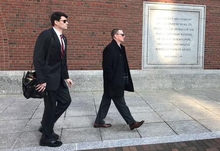 Timothy Sullivan (R), chief of staff of intergovernmental affairs for the city of Boston enters federal court in Boston, Massachusetts, U.S., December 4, 2017.   REUTERS/Nate Raymond