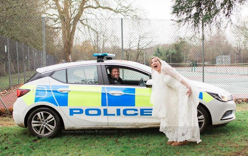 Excited bride poses with police officer (Thames Valley Police)