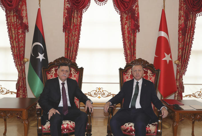 Turkey's President Recep Tayyip Erdogan, right, poses for a photo with Fayez al Sarraj, the head of Libya's internationally-recognized government, in Istanbul, Sunday, Jan. 12, 2020. The meeting at Dolmabahce Palace took place on the first day of a ceasefire in Libya initiated by Turkey and Russia. (Turkish Presidency via AP, Pool)
