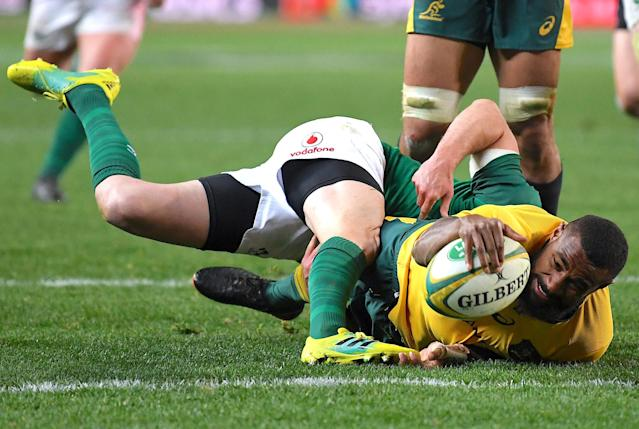 Rugby Union - June Internationals - Australia vs Ireland - Sydney Football Stadium, Sydney, Australia - June 23, 2018 - Australia's Marika Koroibete stretches to score a try. AAP/David Moir/via REUTERS ATTENTION EDITORS - THIS IMAGE WAS PROVIDED BY A THIRD PARTY. NO RESALES. NO ARCHIVE. AUSTRALIA OUT. NEW ZEALAND OUT. TPX IMAGES OF THE DAY