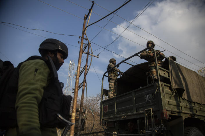 Indian security officers patrol near the site of an attack on the outskirts of Srinagar, Indian controlled Kashmir, Thursday, Nov. 26, 2020. Anti-India rebels in Indian-controlled Kashmir Thursday killed two soldiers in an attack in the disputed region's main city, the Indian army said.(AP Photo/Mukhtar Khan)