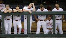 Indiana players watch from the dugout in the ninth inning of their 5-3 loss to Radford in an NCAA college baseball regional tournament game, Sunday, May 31, 2015, in Nashville, Tenn. (AP Photo/Mark Humphrey)