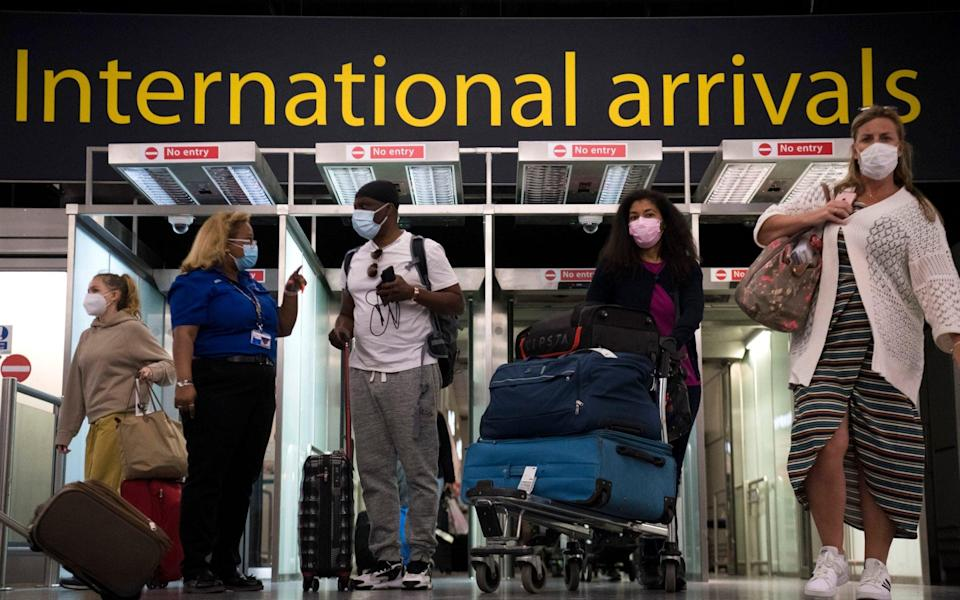 Passengers arrive at Gatwick Airport, West Sussex - Kirsty O'Connor/PA