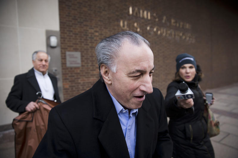 """Joseph """"Uncle Joe"""" Ligambi walks from the U.S. Courthouse, Tuesday, Jan. 28, 2014, in Philadelphia. Federal prosecutors in Philadelphia have dropped its criminal case against the reputed Philadelphia mob boss after a second jury on Friday, Jan. 24, 2014, deadlocked on the central racketeering charge. (AP Photo/Matt Rourke)"""