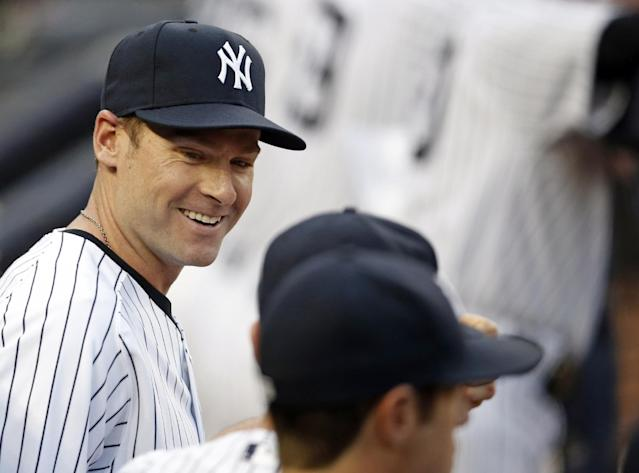 Newly signed New York Yankees third baseman Chase Headley talks during the second inning of a baseball game at Yankee Stadium in New York, Tuesday, July 22, 2014. (AP Photo)