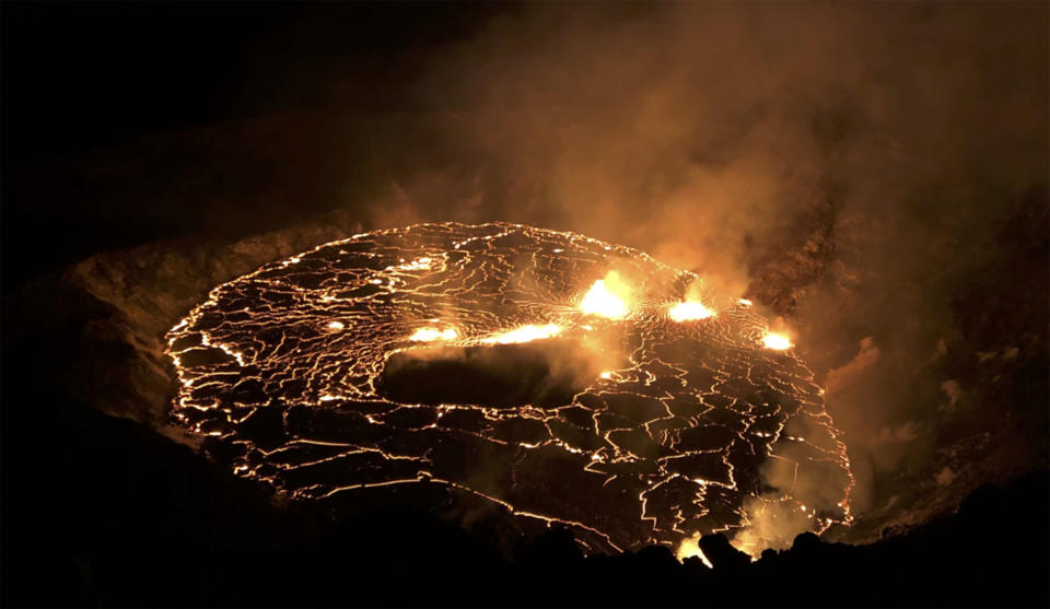 This photo provided by USGS shows the eruption within in Kilauea volcano's Halemaumau crater at the volcano's summit on Wednesday, Sept. 30, 2021. One of the most active volcanos on Earth is erupting on Hawaii's Big Island. (USGS via AP)