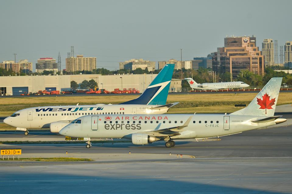 A view of Air Canada and WestJet planes at Toronto Pearson International Airport. On Wednesday, 20 July 2016, in Toronto, Canada. (Photo by Artur Widak/NurPhoto via Getty Images)