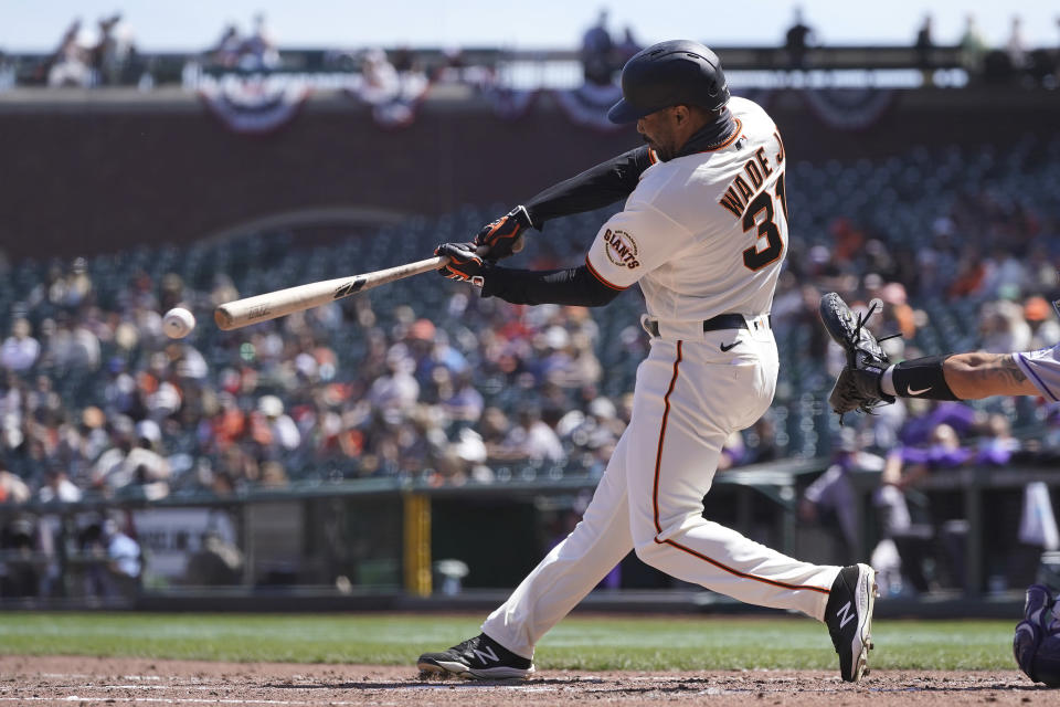 San Francisco Giants' LaMonte Wade Jr. hits a double against the Colorado Rockies during the fifth inning of a baseball game in San Francisco, Sunday, April 11, 2021. (AP Photo/Jeff Chiu)