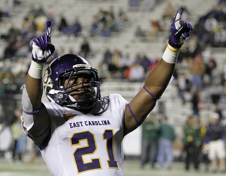 FILE - This Oct. 20, 2012 file photo shows East Carolina running back Vintavious Cooper celebrating after scoring a touchdown to secure the team's 42-35 win over UAB during an NCAA college football game in Birmingham, Ala. A person familiar with the decision tells The Associated Press that Tulane University is joining the Big East as a full member in 2014 and East Carolina will be joining as a football-only member. The person spoke to the AP on condition of anonymity because neither the conference nor school was prepared to make an official announcement.(AP Photo/Butch Dill, File)