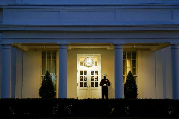 PHOTO: A Marine stands outside the West Wing of the White House at dusk after the House of Representatives voted to impeach President Donald Trump on Jan. 13, 2021, in Washington, D.C. (Drew Angerer/Getty Images)