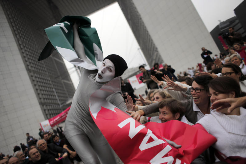 """FILE In this file photo taken on Tuesday Oct. 23, 2012, a man dressed as a bird performs during an anti-gay marriage demonstration in Paris, Tuesday, Oct. 23, 2012. A plan to legalize same-sex marriage and allow gay couples to adopt was a liberal cornerstone of French President Francois Hollande's election manifesto earlier this year. It looked like a shoo-in, supported by a majority of the French, and an easy way to break with his conservative predecessor. But that was then, Now, as the Socialist government prepares to unveil its draft """"marriage for everyone"""" law Wednesday, polls show wavering support for the idea and for the president amid increasingly vocal opposition in this traditionally Catholic country. (AP Photo/Christophe Ena, File)"""