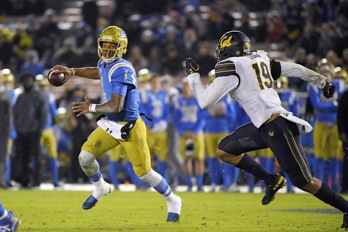 "UCLA fall sports athletes — including football players, such as quarterback Dorian Thompson-Robinson — who live within a 50-mile radius of campus are the first group slated to return to campus. <span class=""copyright"">(Mark J. Terrill / Associated Press)</span>"