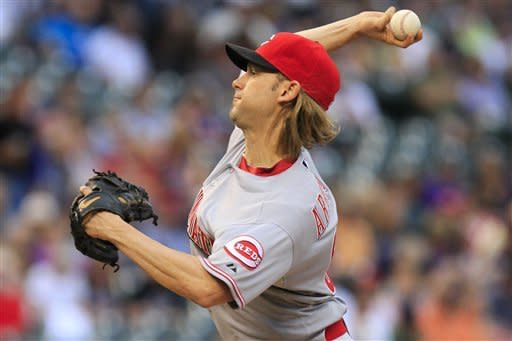 Cincinnati Reds starting pitcher Bronson Arroyo challenges Colorado Rockies' Dexter Fowler during the first inning of a baseball game on Friday, July 27, 2012, in Denver. (AP Photo/Barry Gutierrez)