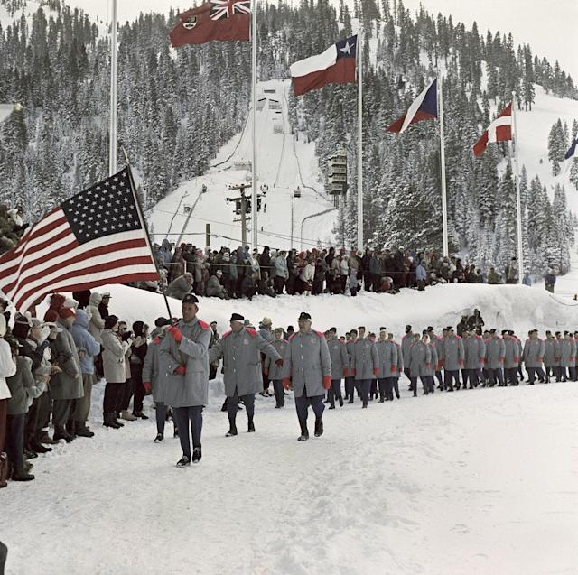 Teams enter arena for the Winter Olympic games opening ceremony in Squaw Valley, Calif., in January 1960. (AP Photo)
