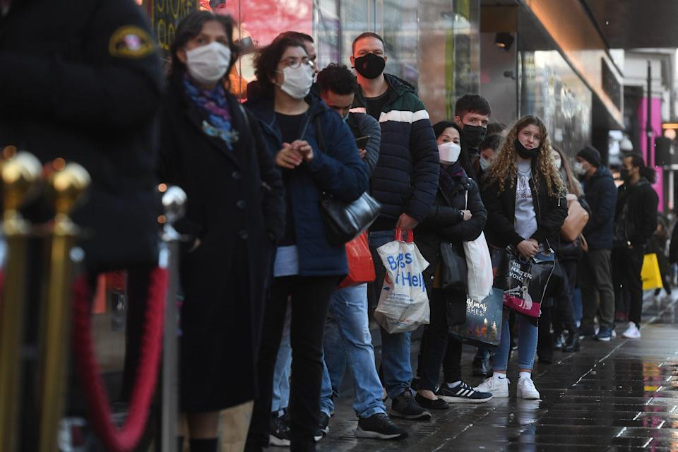 <p>People shopping on Oxford Street in central London</p> (PA)