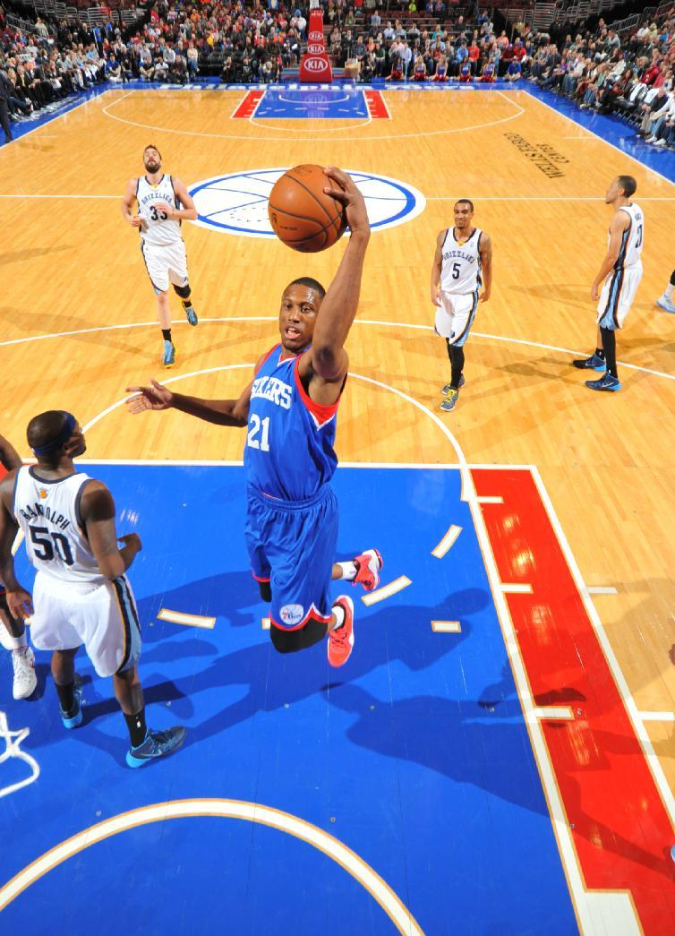 PHILADELPHIA, PA - MARCH 15: Thaddeus Young #21 of the Philadelphia 76ers goes up for the layup against the Memphis Grizzlies at the Wells Fargo Center on March 15, 2014 in Philadelphia, Pennsylvania. (Photo by Jesse D. Garrabrant/NBAE via Getty Images)
