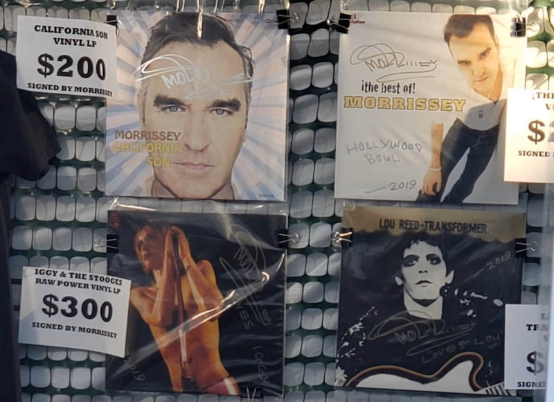 Morrissey is signing other artists' albums and selling them for $300 at shows