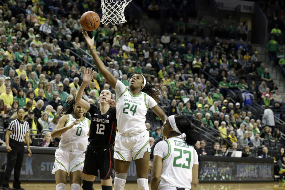 Oregon Ducks forward Ruthy Hebard (24) grabs a rebound against Stanford on Monday in Eugene. Mandatory Credit: Soobum Im-USA TODAY Sports