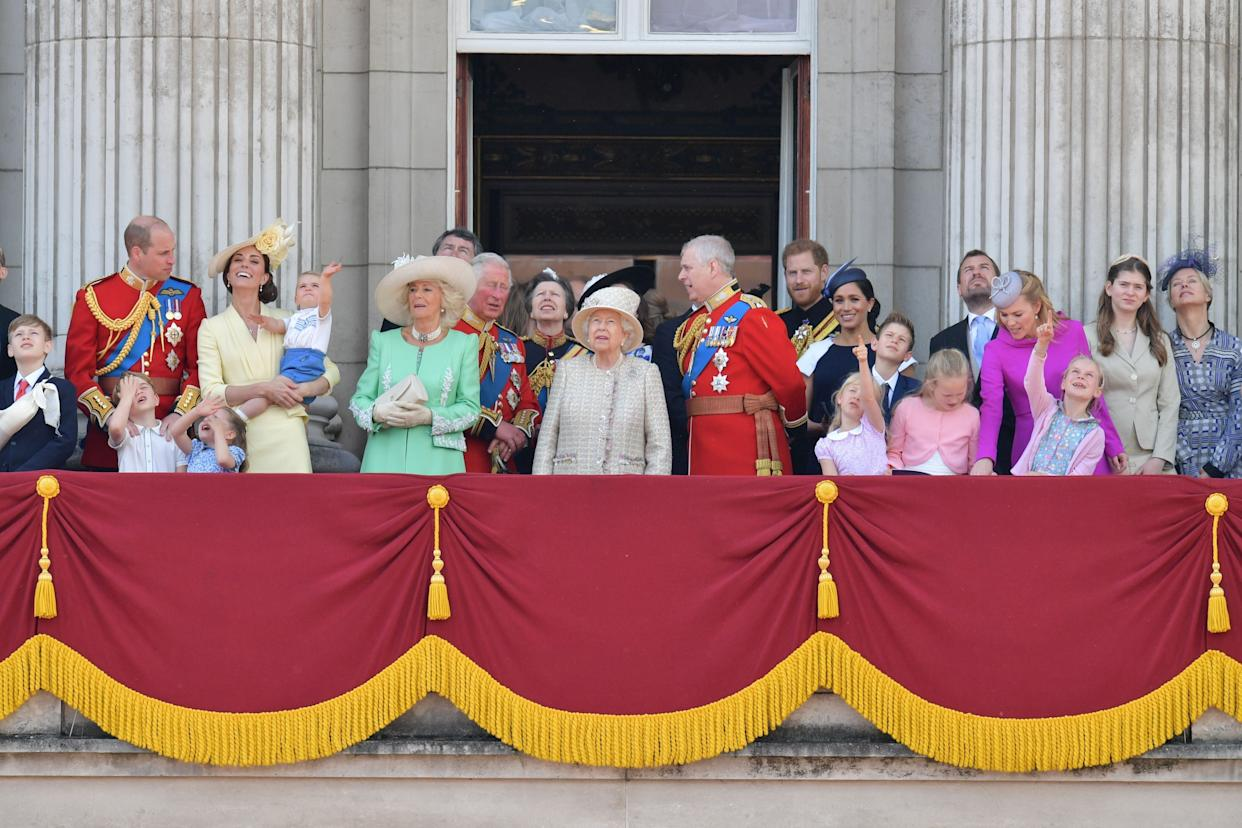 Prince Harry and Meghan Markle pictured on the balcony for Trooping the Colour, standing in the back behind Prince Andrew