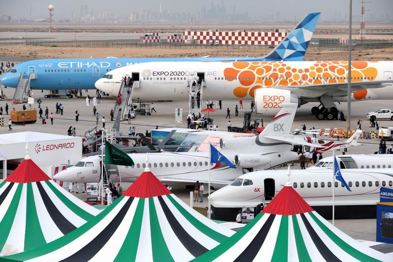 Aircraft sit on static display during the fifth day of Dubai Air Show in Dubai