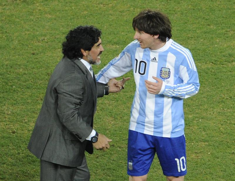 Argentina's striker Lionel Messi (R) is congratulated by Argentina's coach Diego Maradona at the end of the 2010 World Cup round of 16 football match Argentina vs. Mexico on June 27, 2010 at Soccer City stadium in Soweto, suburban Johannesburg. Argentina defeated Mexico 3-1.NO PUSH TO MOBILE / MOBILE USE SOLELY WITHIN EDITORIAL ARTICLE - AFP PHOTO / JAVIER SORIANO (Photo credit should read JAVIER SORIANO/AFP via Getty Images)