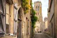 """<p><strong>Population:</strong> 434</p> <p>The medieval hilltop town of Vézelay is a can't-miss stop on any <a href=""""https://www.cntraveler.com/story/road-trip-3-days-in-burgundy-france?mbid=synd_yahoo_rss"""" rel=""""nofollow noopener"""" target=""""_blank"""" data-ylk=""""slk:Burgundy road trip"""" class=""""link rapid-noclick-resp"""">Burgundy road trip</a>. Make sure your detour includes a visit to the aptly-named Vézelay Abbey, where you'll be afforded plenty of sweeping views of the surrounding countryside.</p>"""