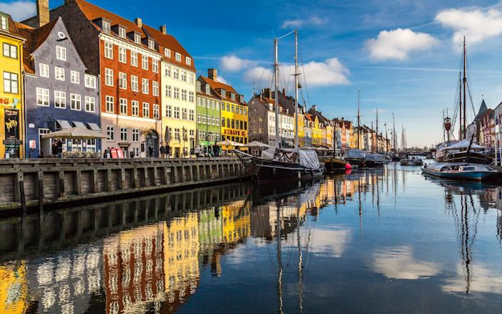 Nyhavn is a 17th-century waterfront, canal and entertainment district in Copenhagen, Denmark -  HAGENS WORLD PHOTOGRAPHY