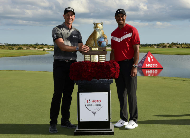 Henrik Stenson, left, poses with Tiger Woods, after winning the Hero World Challenge at the Albany Golf Club in Nassau, Bahamas, Saturday, Dec. 7, 2019. (AP Photo/Dante Carrer)