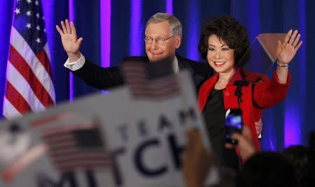 U.S. Senate Minority Leader Mitch McConnell waves to supporters with his wife Elaine Chao at his midterm election night rally in Louisville