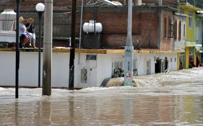 Around 1,000 people were moved to shelters, though some were reluctant to abandon their homes (AFP/FRANCISCO VILLEDA)