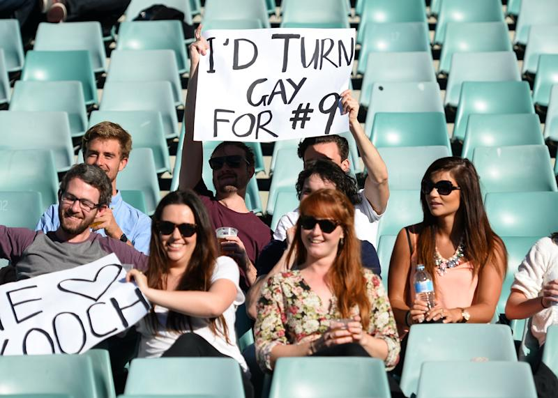 Fans of the Sydney Convicts, an all-gay rugby team, cheer as they play against Macquarie University at the Allianz Stadium in Sydney on July 6, 2014