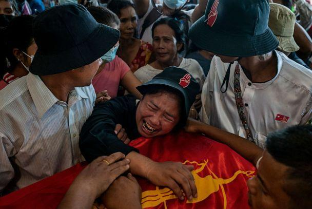 PHOTO: A sister of Zwal Htet Soe, 26, mourns over the coffin containing his body during a funeral for protesters who were shot dead in clashes with military and police on March 05, 2021, at the Yay Way cemetery in Yangon, Myanmar. (Stringer/Getty Images)