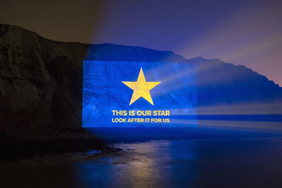 Handout photo issued by Led By Donkeys of a message reading 'this is our star, look after it for us' being projected onto the side of the White Cliffs of Dover. PA Photo. Picture date: Friday January 31, 2020. It comes ahead of the UK leaving the European Union at 11pm on Friday. See PA story POLITICS Brexit Cliffs. Photo credit should read: Led By Donkeys/PA Wire  NOTE TO EDITORS: This handout photo may only be used in for editorial reporting purposes for the contemporaneous illustration of events, things or the people in the image or facts mentioned in the caption. Reuse of the picture may require further permission from the copyright holder.
