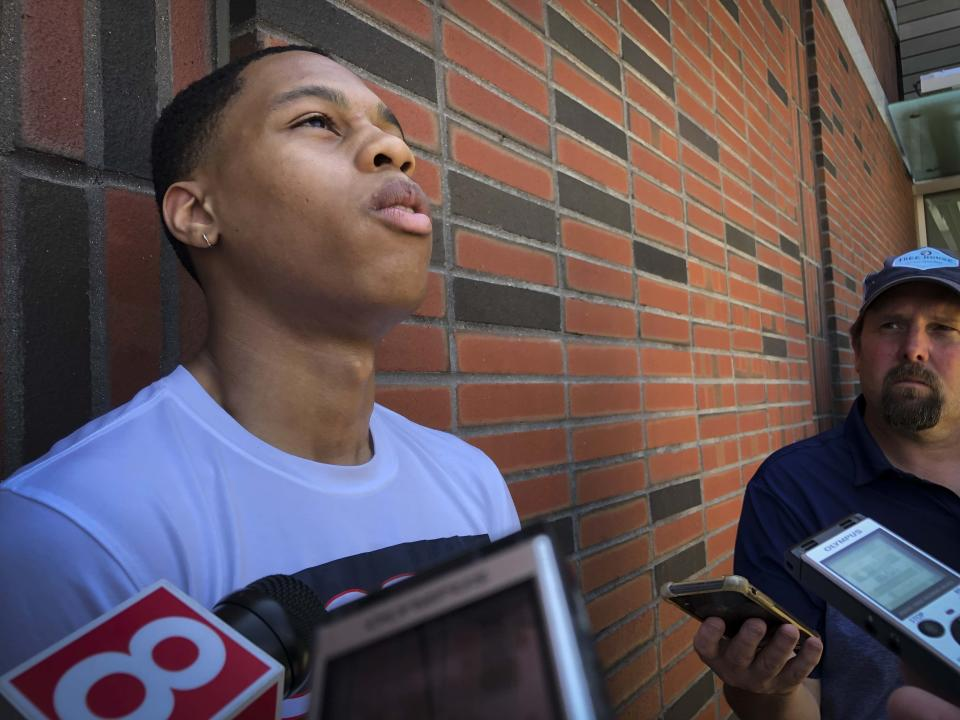Incoming UConn freshman Jordan Hawkins speaks to the media outside the school's Werth basketball center on Wednesday, June 30, 2021, in Storrs, Conn. Hawkins is part of a highly touted 3-member recruiting class that is expected to help the Huskies compete for a Big East championship. (AP Photo/Pat Eaton-Robb)