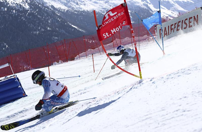 Slovakia's Adam Zampa, left, and France's Alexis Pinturault compete in a parallel race during a team event, at the alpine ski World Championships, in St. Moritz, Switzerland, Tuesday, Feb. 14, 2017. (AP Photo/Alessandro Trovati)