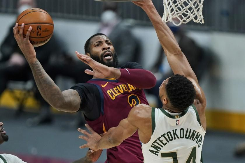 Cleveland Cavaliers' Andre Drummond (3) drives to the basket against Milwaukee Bucks' Giannis Antetokounmpo.