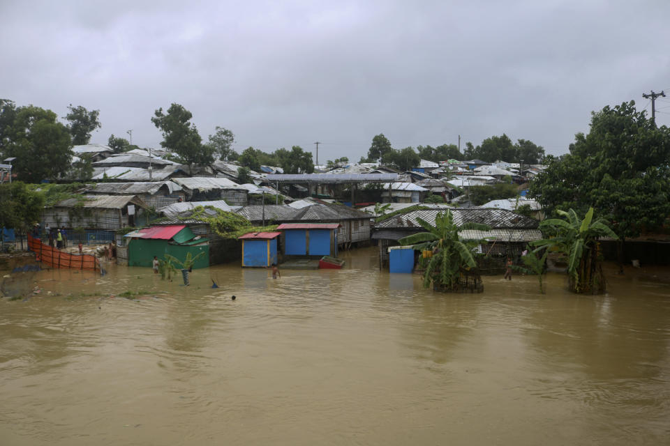 A view of inundated shelters following heavy rains at the Rohingya refugee camp in Kutupalong, Bangladesh, Wednesday, July 28, 2021. Days of heavy rains have brought thousands of shelters in various Rohingya refugee camps in Southern Bangladesh under water, rendering thousands of refugees homeless. (AP Photo/ Shafiqur Rahman)