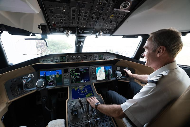 A pilot sits inside the cockpit of a Bombardier Inc. Global 6000 business jet during a media event at Seletar Aerospace Heights in Singapore, on Wednesday, Feb. 27, 2019. Bombardier is more than doubling the size of its bond buybacks to as much as $1.83 billion after raising twice the amount initially expected in its new debtsaleon Thursday amid a red-hot junk-bond market. Photographer: Nicky Loh/Bloomberg via Getty Images