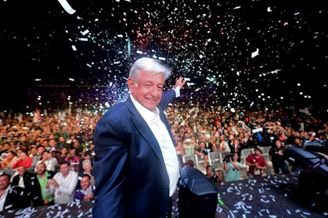 Mexico's president-elect Andres Manuel Lopez Obrador (C) cheers his supporters at the Zocalo Square in Mexico City after winning general elections [AFP]