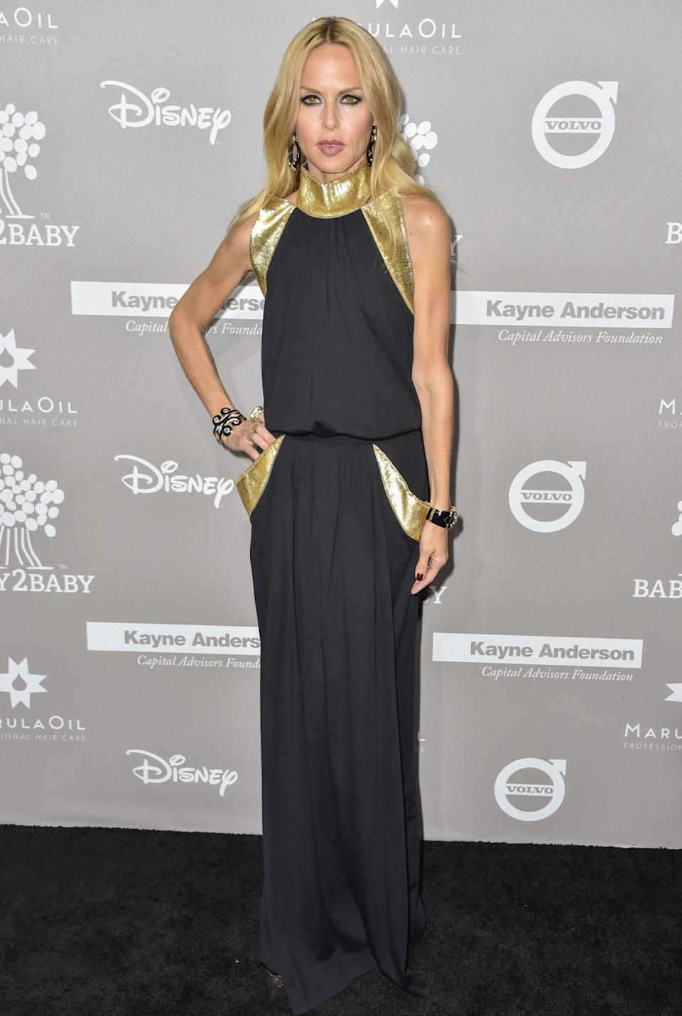 Stylist-to-the-stars Rachel Zoe, a mum of two, opted for a black and gold gown and a pair of statement wrist cuffs. [Photo: Rex]