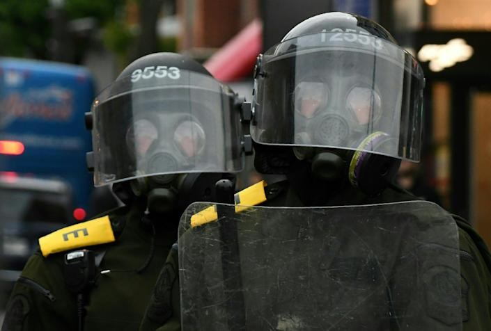 <p>Riot police wearing gas masks look on during an anti-G7 demonstration in Quebec City, Quebec, June 7, 2018, on the eve of the leaders' summit. (Photo: Martin Ouellet-Diotte/AFP/Getty Images) </p>