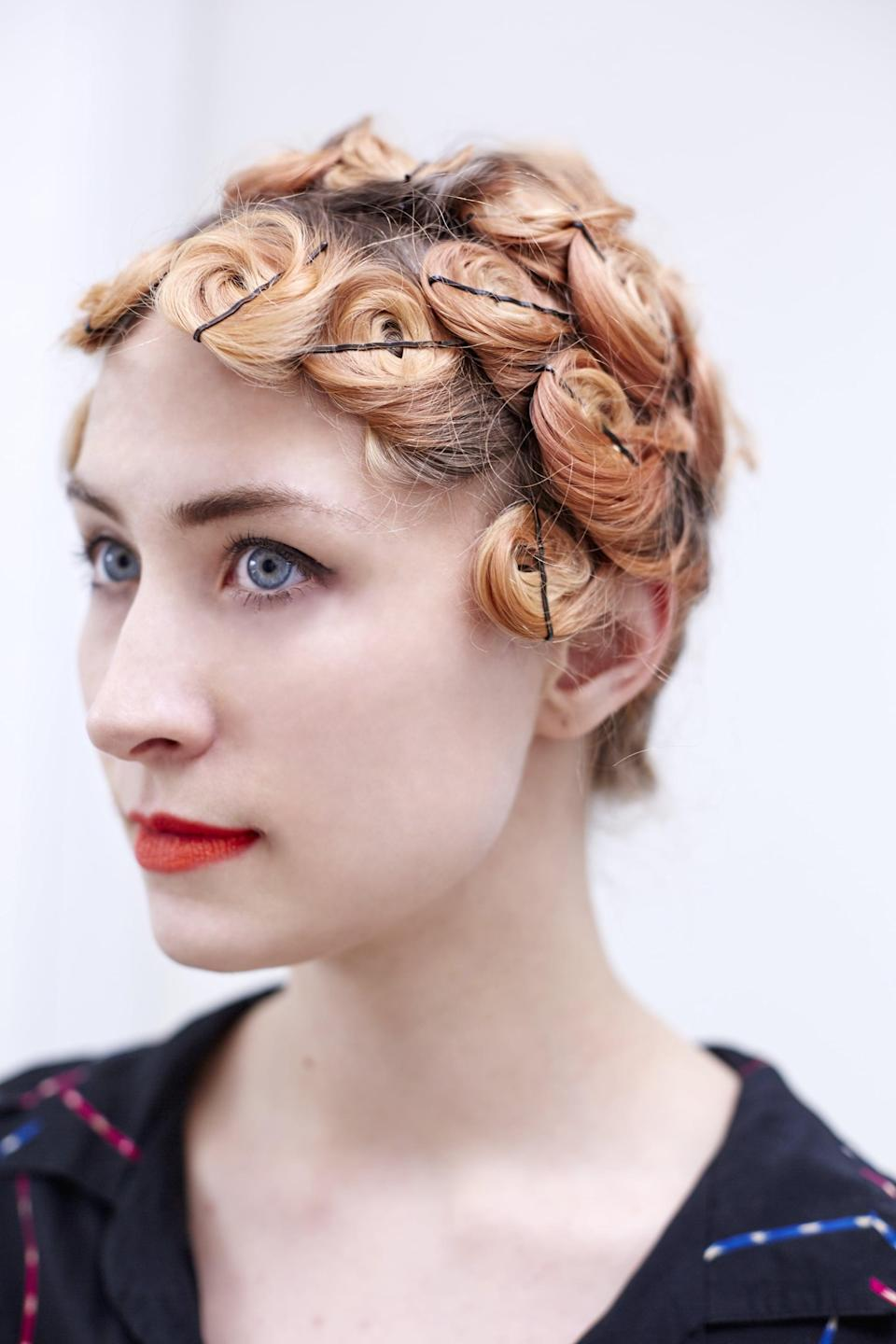 <p>Continue this process until all of your hair is pinned up. Once you're finished, air-dry or diffuse your hair with a blowdryer until it feels done. If you'd like, you can wrap your hair in a silk scarf and sleep on it overnight to ensure that it's completely dry and the curls set.</p>
