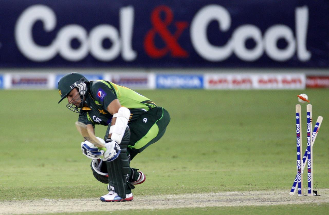 Pakistan's Saeed Ajmal gets bowled during their first Twenty20 international cricket match against South Africa in Dubai November 13, 2013. REUTERS/Nikhil Monteiro (UNITED ARAB EMIRATES - Tags: SPORT CRICKET)