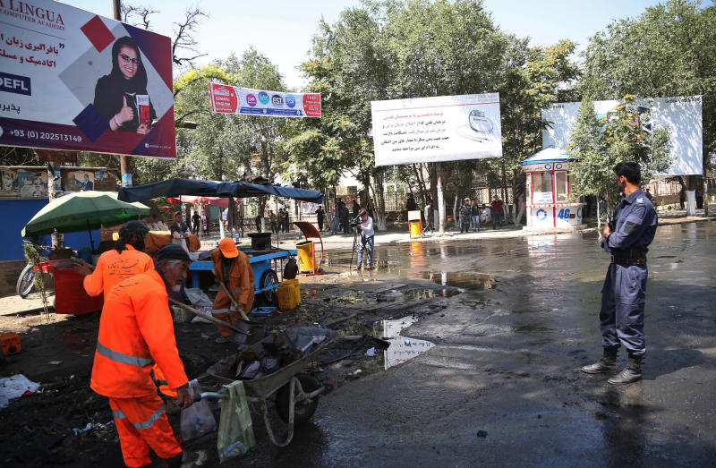 Afghan security forces stand guard near the site of an explosion in Kabul, Afghanistan, Friday, July 19, 2019. A powerful bomb exploded outside the gates of Kabul University in the Afghan capital on Friday, according to police and health officials. (AP Photo)
