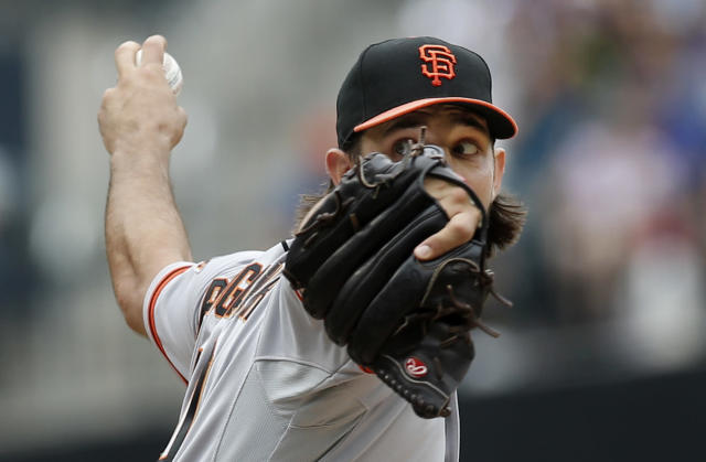 San Francisco Giants starting pitcher Madison Bumgarner winds up in the first inning of a baseball game against the New York Mets in New York, Sunday, Aug. 3, 2014. (AP Photo/Kathy Willens)