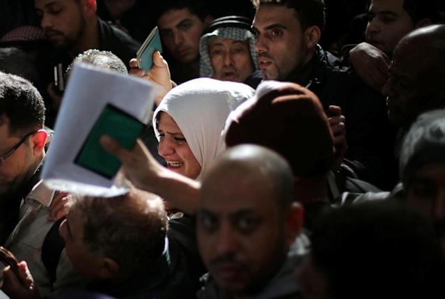 <p>A woman cries as she asks for a travel permit to cross into Egypt through the Rafah border crossing after it was opened by Egyptian authorities for humanitarian cases, in the southern Gaza Strip, Feb. 8, 2018. (Photo: Ibraheem Abu Mustafa/Reuters) </p>
